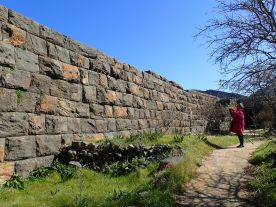 Adriana at the base of the ancient city walls